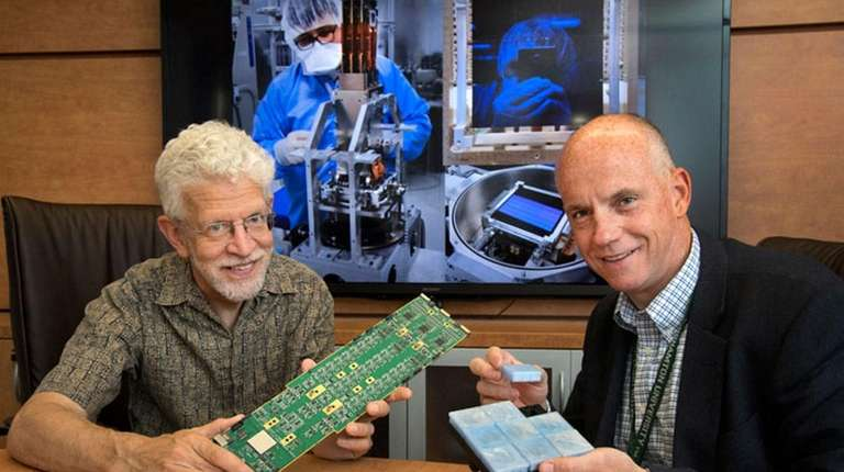 Paul O'Connor and Bill Wahl with components of