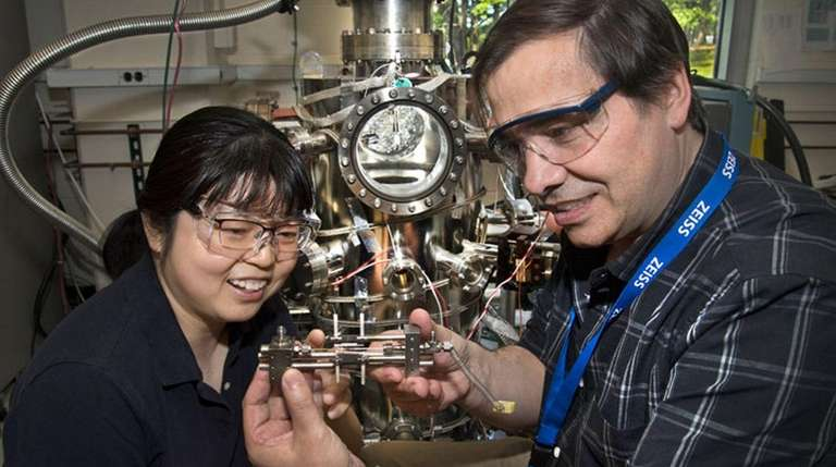 Brookhaven Lab chemists Ping Liu and José Rodriguez
