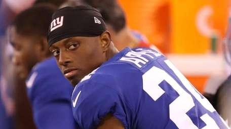 Giants cornerback Eli Apple sits on the bench