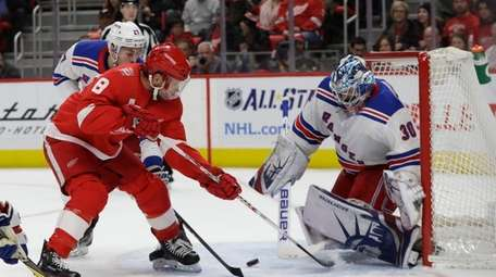 Red Wings left wing Justin Abdelkader shoots the