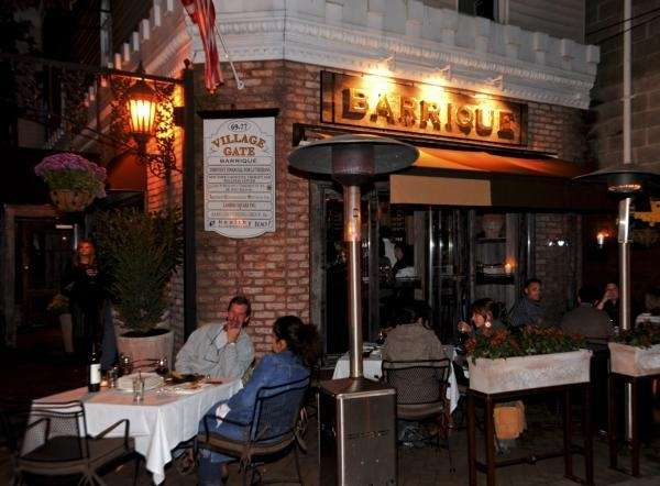 Patrons dine outside under heat lamps at Barrique