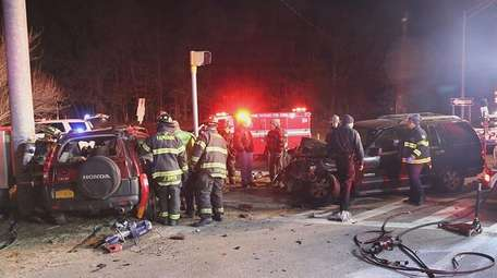 Police respond to a crash on Patchogue-Yaphank Road