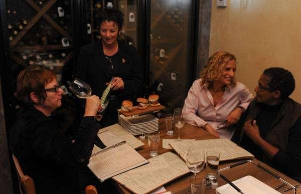 Sommelier Gwenn Goichman offers wine samples to patrons