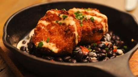 Crab cake with black bean salsa with chili