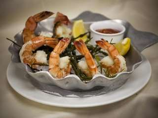 Colossal shrimp are served as an appetizer at