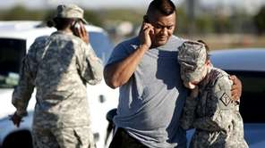 Sgt. Fanuaee Vea embraces Pvt. Savannah Green while