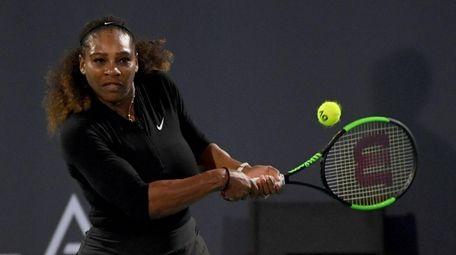 Serena Williams hits a forehand against Jelena Ostapenko