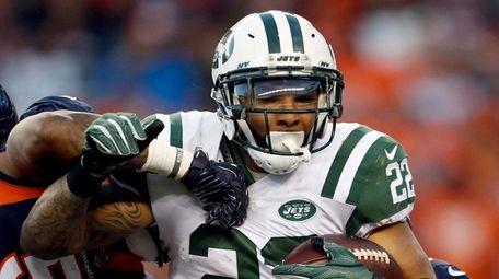 Jets running back Matt Forte is hit by