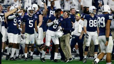 Penn State players celebrate during the final seconds