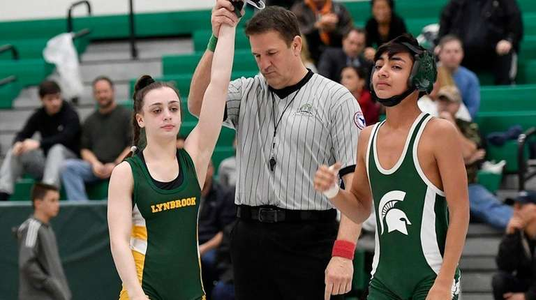 Lynbrook wrestler Ally Fitzgerald, left, was victorious in