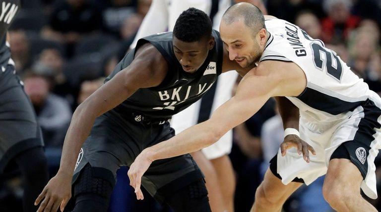 Nets guard Caris LeVert and Spurs guard Manu