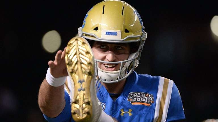 UCLA quarterback Josh Rosen warms up on the