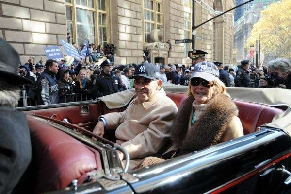 Yankees great Yogi Berra rides in the World