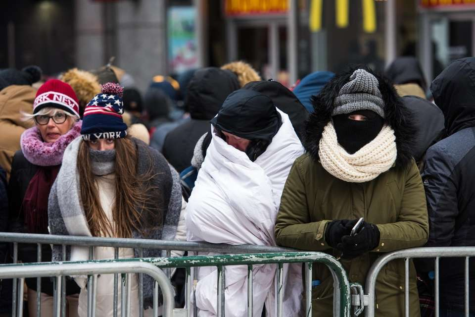 Revelers in the cold at Times Square before