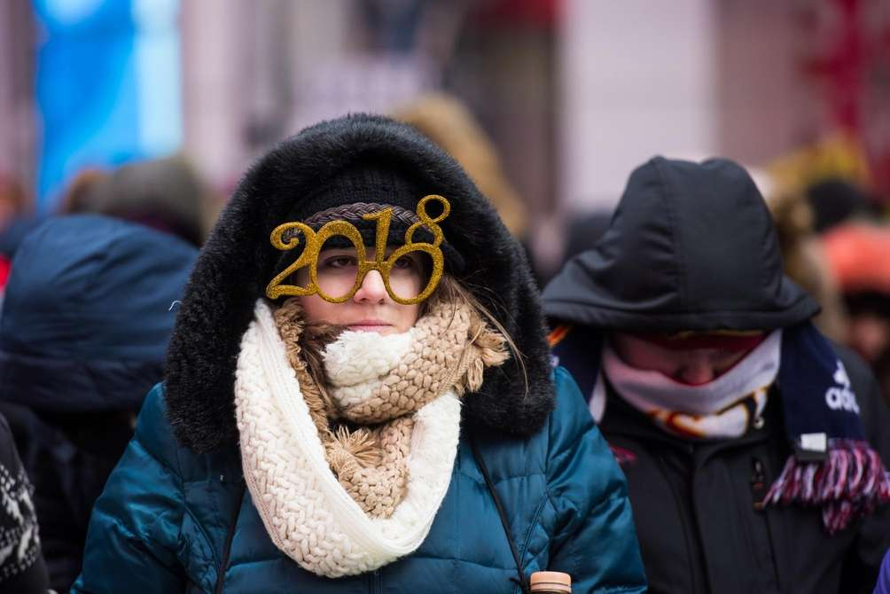 A woman sporting festive glasses in Times Square