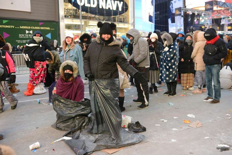 New Year's Eve revelers crawl into garbage bags