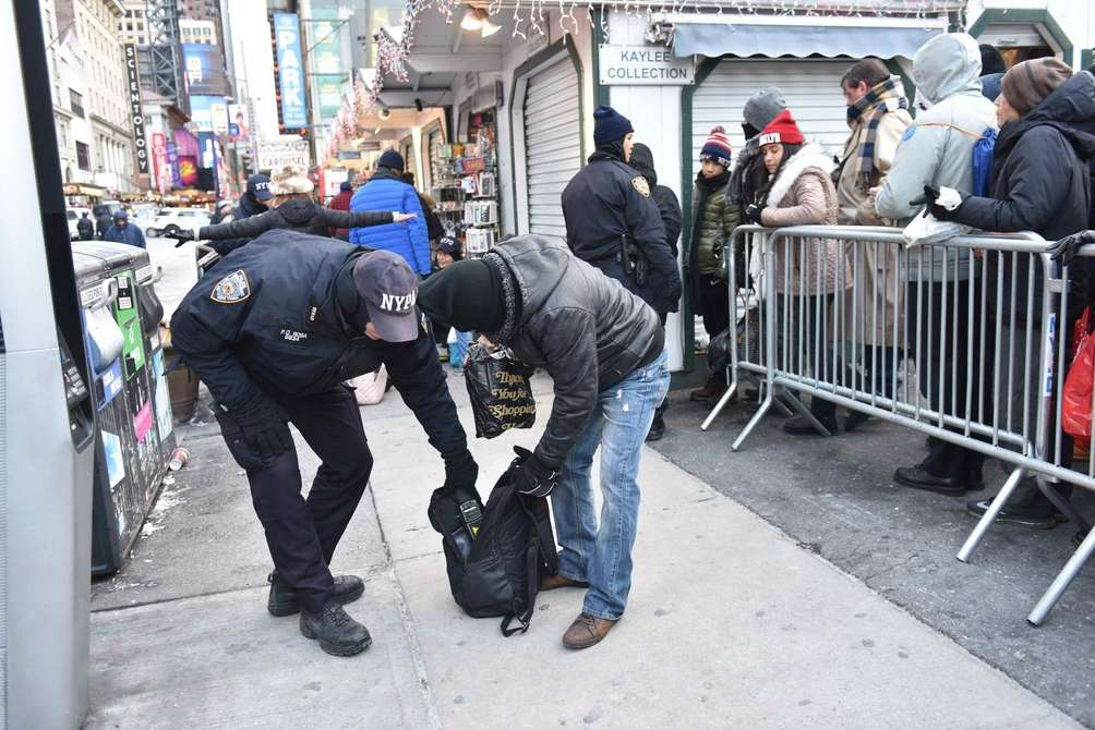 Cops search a bag as New Year's Eve