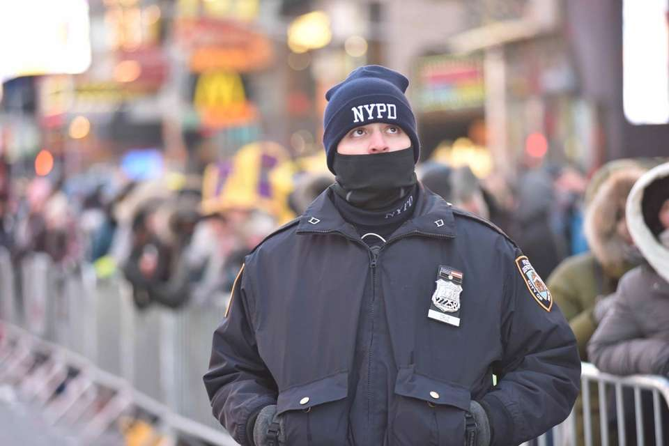 An officer is bundled up as New Year's