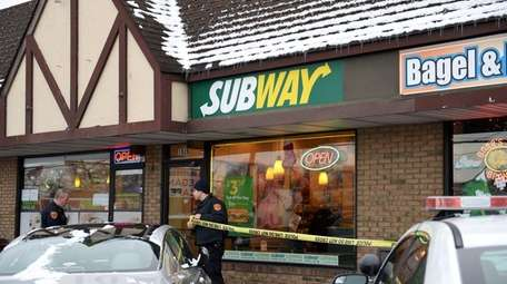Suffolk County police at scene of a robbery