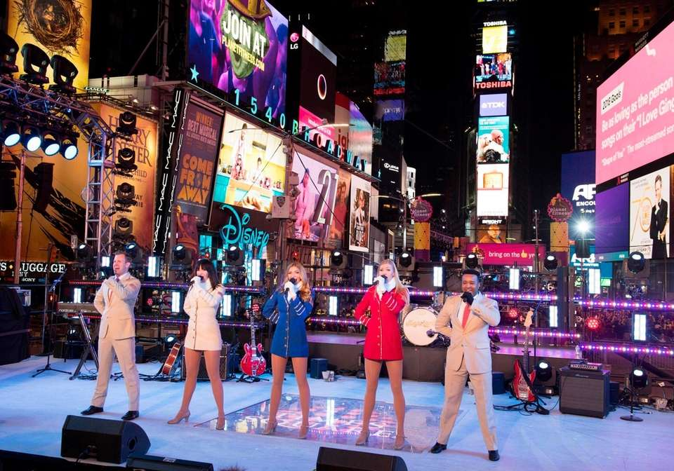 USO entertainers perform during New Year's Eve celebrations