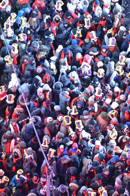 New Year's Eve revelers celebrate in a frigid