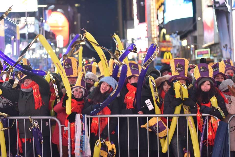 New Year's Eve revelers celebrate in a frigid