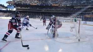 Rangers defenseman Kevin Shattenkirk controls the puck as
