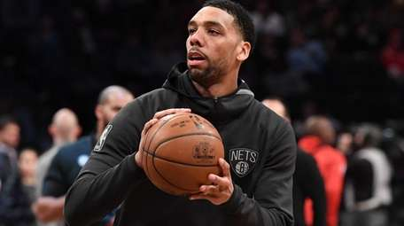 Nets center Jahlil Okafor warms up before a