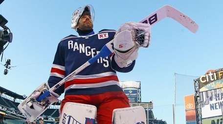 The Rangers' Henrik Lundqvist leaves the ice following