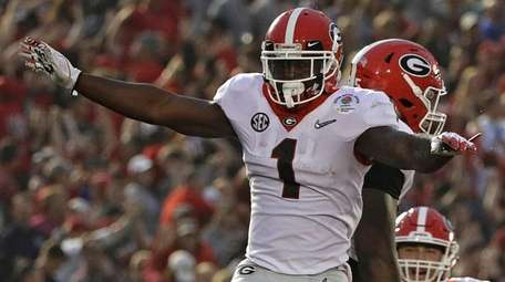 Georgia running back Sony Michel celebrates with Kendall