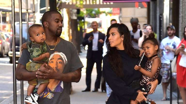 Kanye West and Kim Kardashian with son Saint