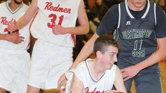 East Islip's Joseph Cassiano (15) handles the ball