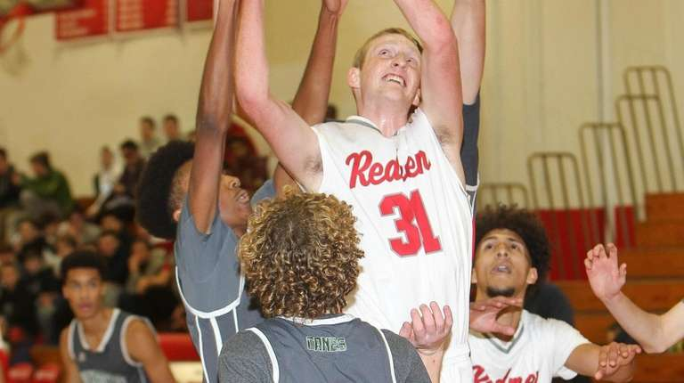 East Islip's Greg Cassiano (31) drives to the