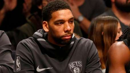 Jahlil Okafor of the Nets looks on from