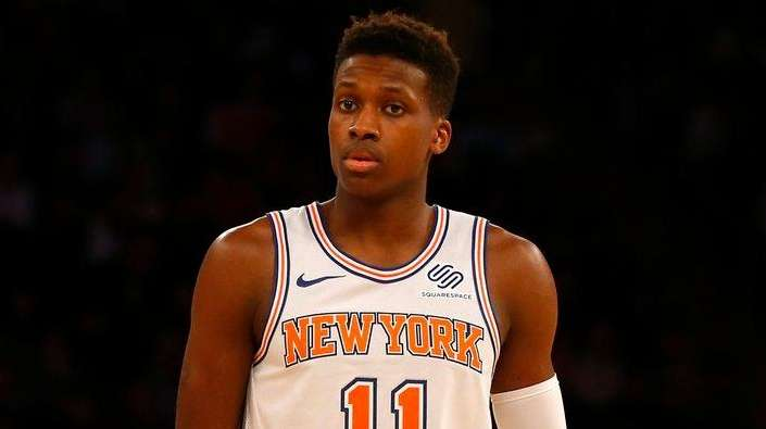 Frank Ntilikina of the Knicks and Tony Parker