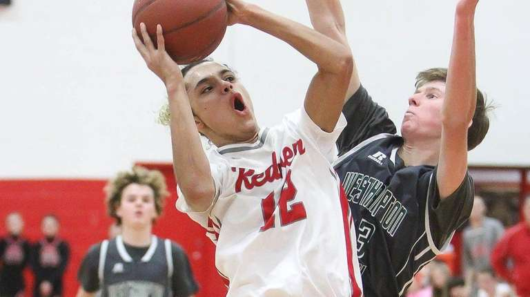 East Islip's Jordan Mosley goes up for a
