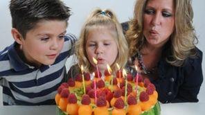 James Michels, 7, his sister Lauren, 5, and