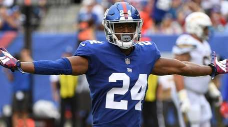 Giants cornerback Eli Apple reacts to a call