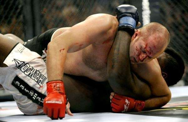 Fedor Emelianenko of Russia, top, fights Brett Rogers
