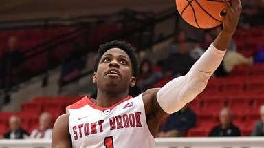 Stony Brook guard UC Iroegbu puts up a