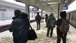 LIRR commuters wait for their train at the