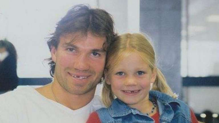 Luke Richardson with his daughter Daron in an