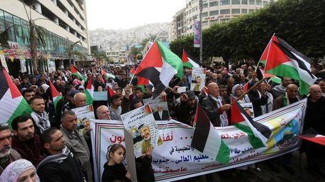 Palestinians protest on Dec. 31, 2017 the decision