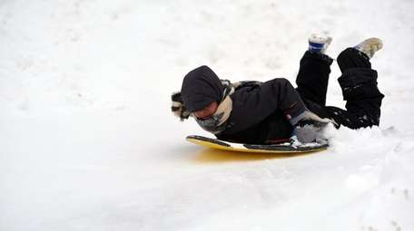 Neal Myer, 9, of Syosset, sleds on a