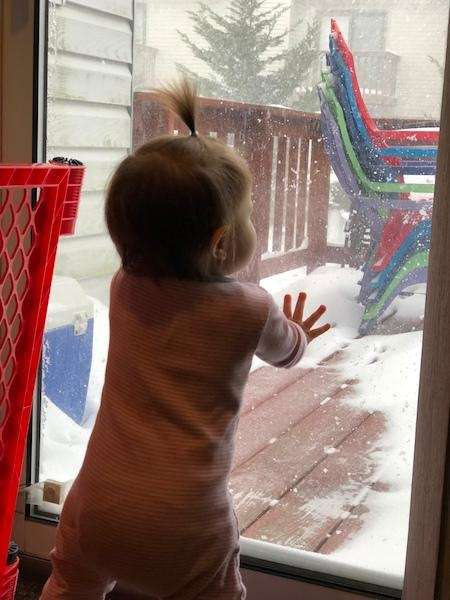 Aleena fascinated by all the snow. Her first