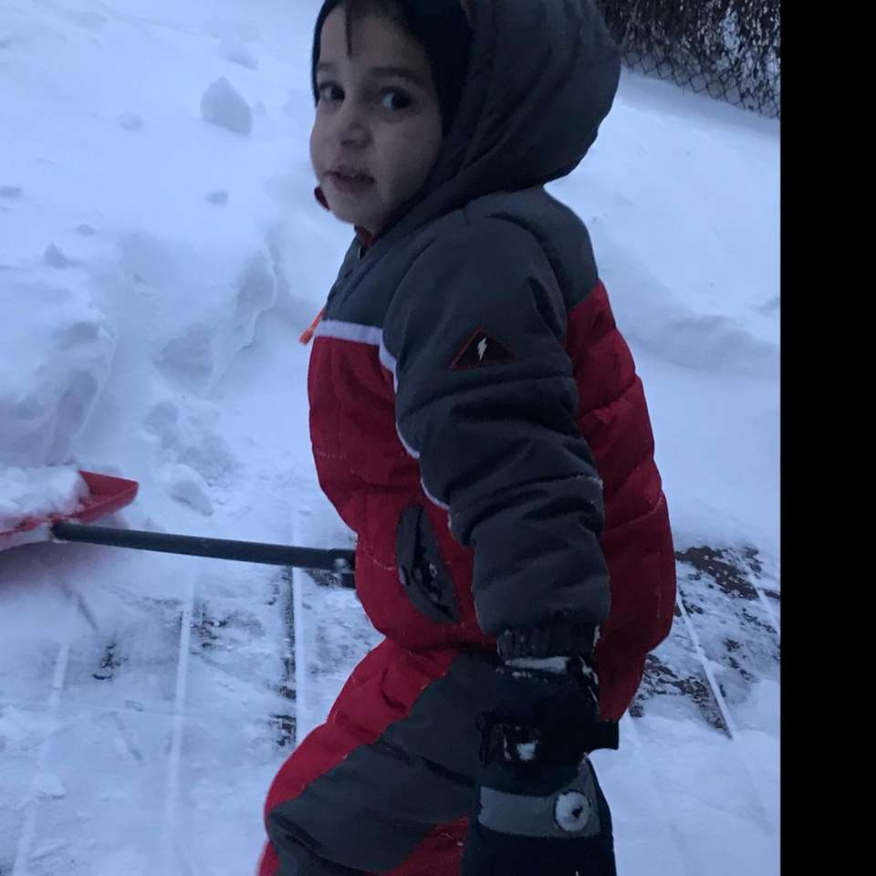 Michael helping Mom shovel with his new red
