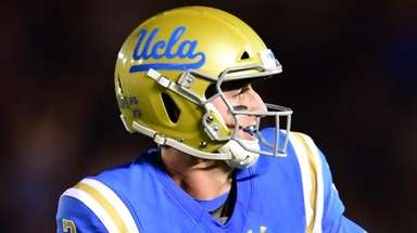 UCLA quarterback Josh Rosen celebrates a touchdown pass
