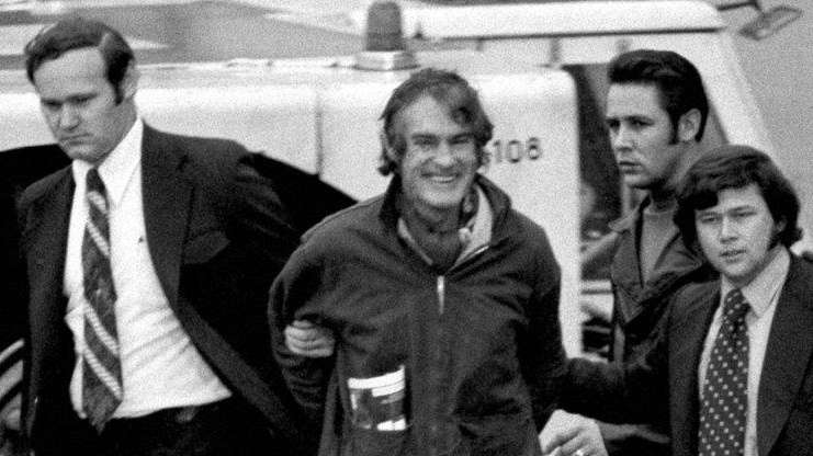 Timothy Leary escorted by federal narcotics agents as