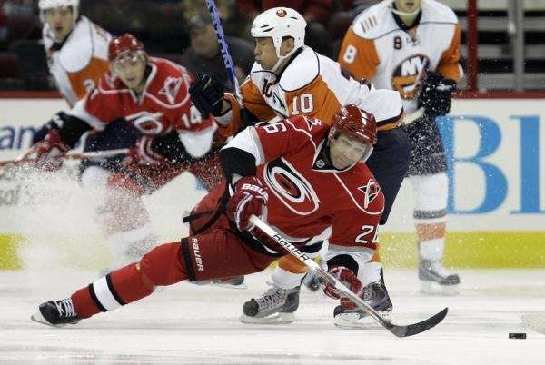 Carolina Hurricanes' Erik Cole (26) falls to the