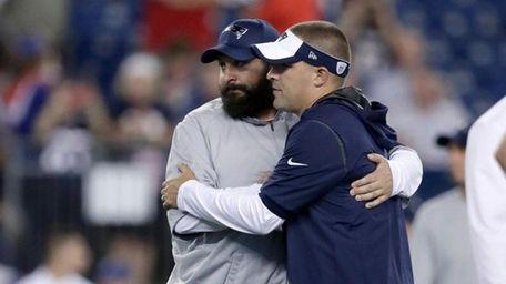 Patriots defensive coordinator Matt Patricia embraces offensive coordinator